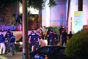Police stand outside the Emanuel AME Church following…