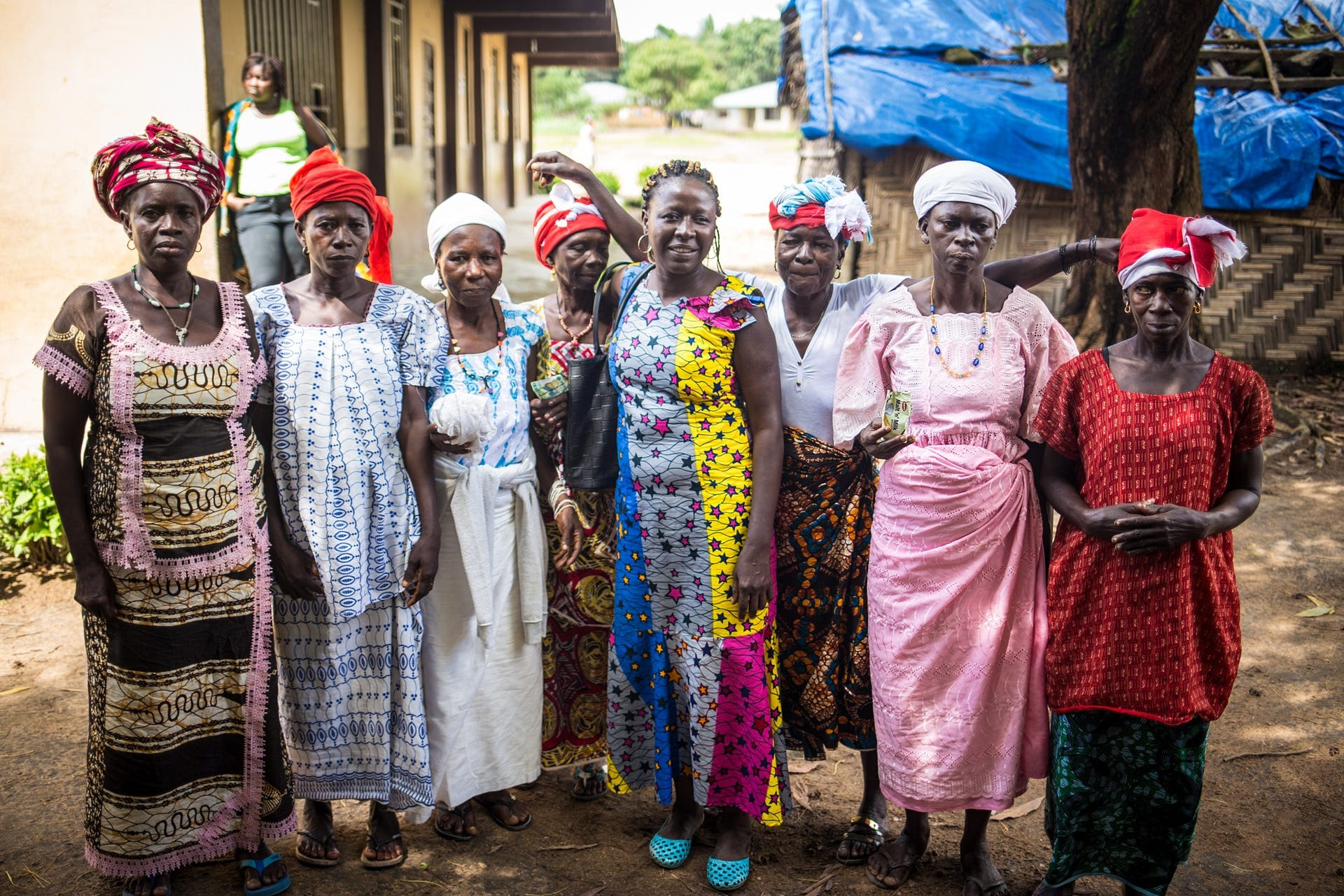 A group of soweis, the most senior women in the Bondo secret societies. The chiefdoms head sowei, seen here wearing a pink dress, is Jeanette Bangura. In the centre, wearing a yellow and blue dress, is Ann-Marie Caulker, an anti-FGM campaigner.
