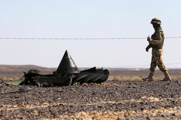 An Egyptian army soldier stands guard near debris from a Russian airliner