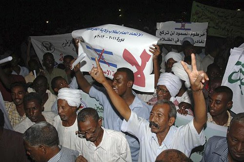 Sudanese demonstrate against the Israeli air attack caried out on a arms factory. The Israeli actions have been condemned by the Non-Aligned Movement. by Pan-African News Wire File Photos