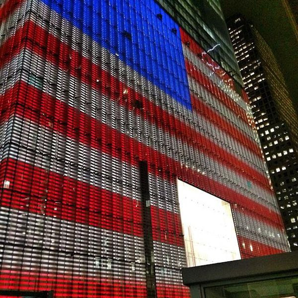 The glass panels enshrouding 1 WTC's base structure glow in patriotic colors on October 23, 2014.