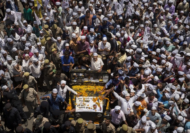 Drawing the crowds, AAP leader and anti-corruption activist Arvin Kejriwal makes his way to file his nomination papers in Varanasi, India, confirming his decision to run against BJP leader Narendra Modi.