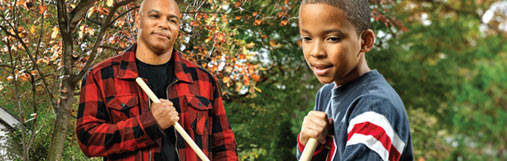 Picture of a father and son raking leaves