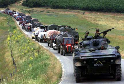 Serbs leaving their homes under NATO escort
