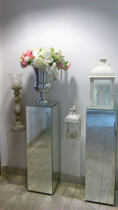 tall mirrored pillars with lanterns and vases   Tuscan