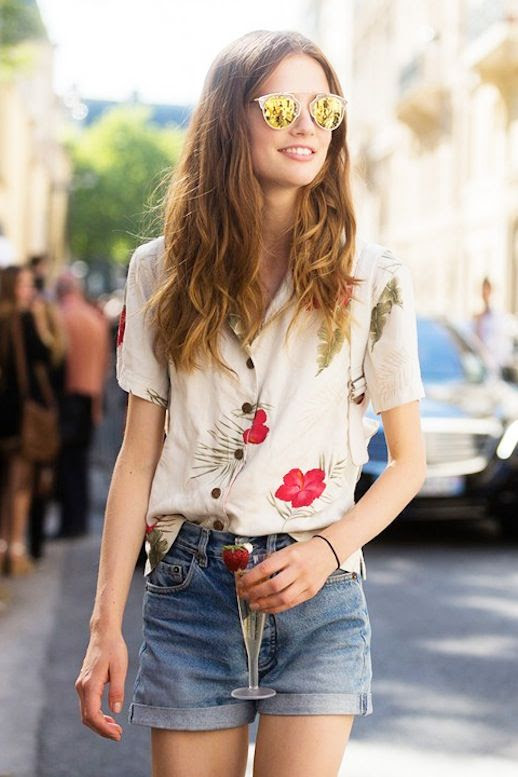 Le Fashion Blog Blogger Model Off Duty Street Style Fun Summer Look Mirrored Sunglasses Tropical Floral Print Button Down Shirt With Short Sleeves Cuffed Denim Shorts Via British Vogue