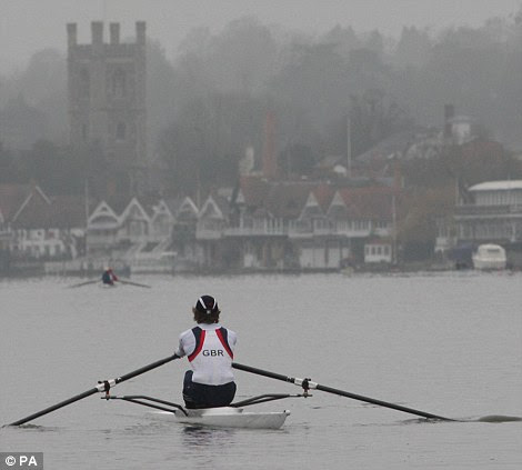 Rowers train in misty conditions on the River Thames at Henley in Oxfordshire