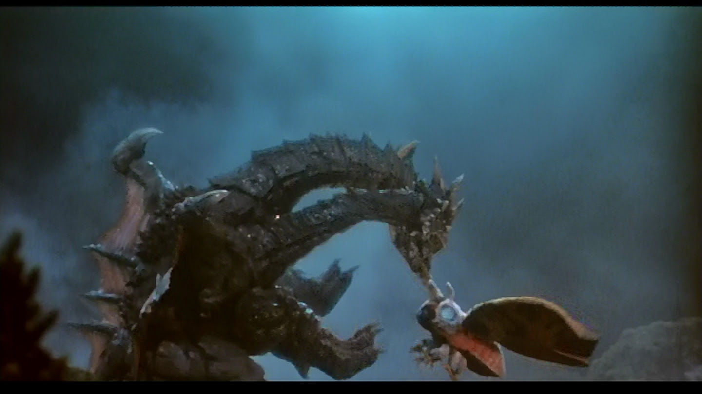 Death Ghidorah gnaws on Mothra