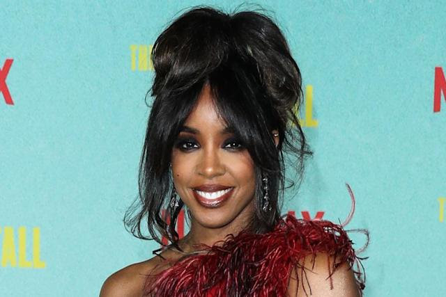 Kelly Rowland Gets Edgy in a Red Feather Dress & Leather Gloves for 'The Harder They Fall' Premiere