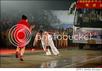 He Jianma Pulls 9-Ton Bus