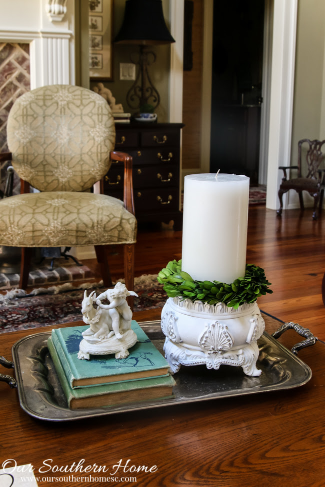 Wow! A little spray paint can completely transform a home decor piece. Now it so fits into a French Farmhouse style!