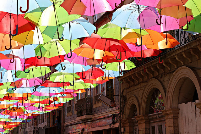 A Canopy of Colorful Umbrellas Spotted in Portugal umbrellas Portugal installation