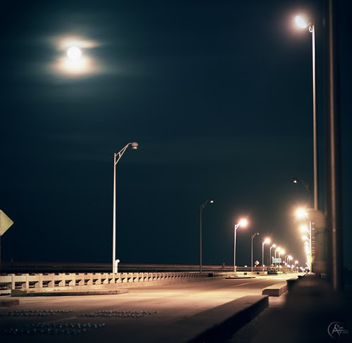 Moon over the pier by Savage Land Pictures