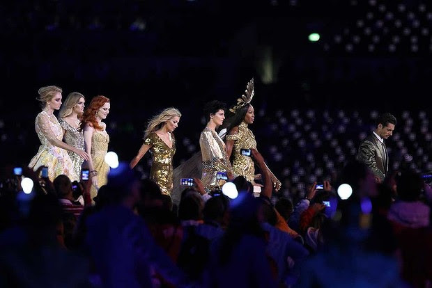 Quite the spectacle: Great Britain's most famous supermodels take to the stage in front of the 80,000-strong stadium crowd.