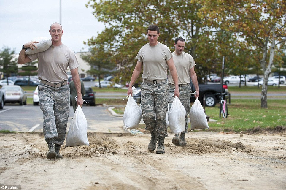 All hands on deck: Members of the Joint Base prepare for the impact of Hurricane Sandy by sandbagging low lying areas at Joint Base McGuire-Dix-Lakehurst, New Jersey