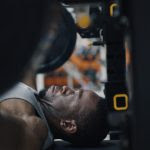 Garrison Redd laying on his back and lifting weights