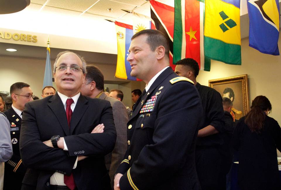 ROBIN TRIMARCHI rtrimarchi@ledger-enquirer.com Col. Keith Anthony, WHINSEC commandant, right, and Frank Mora, director of the Ameican and Caribbean Center, School of International and Public Affairs at Florida International University, talk during a reception for the Western Hemisphere Institute for Security Cooperation 15th anniversary Thursday. 01.14.16