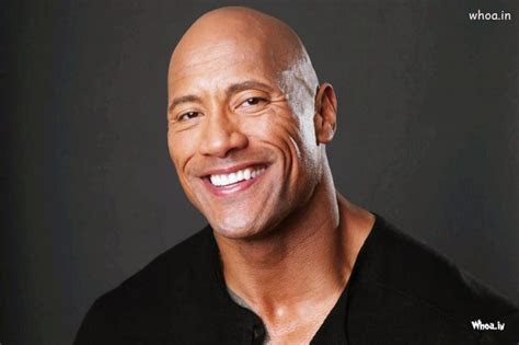 dwayne johnson  rock dark background  smiley face