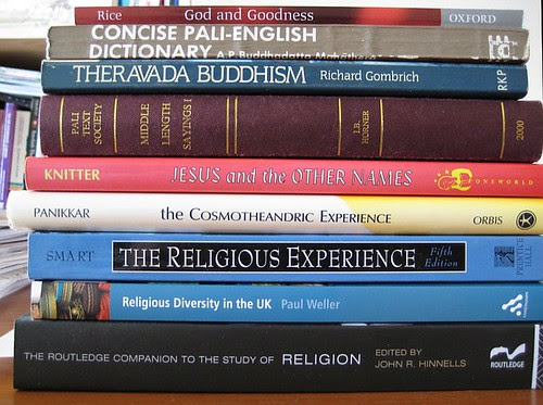 A small stack of books for religious studies