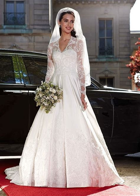Wedding Dress: Long Sleeved Satin and Lace Ball Gown   Yes