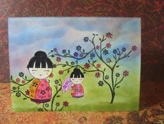 Two dolls on one layer card