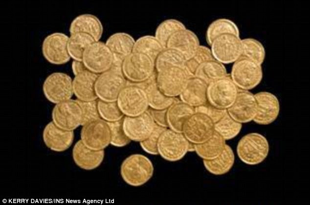 Lucky find: Mr Carrington discovered a hoard of solid-gold Solidi dating back nearly 1,700 years to the decline of the Roman Empire