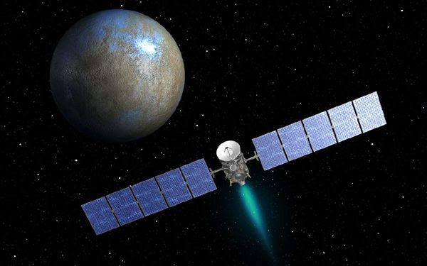 An artist's concept of NASA's Dawn spacecraft approaching the dwarf planet Ceres.