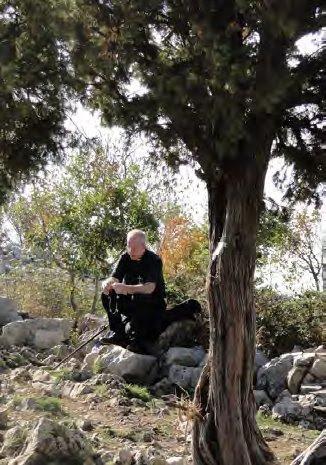 Fr. Ray praying on Cross Mountain