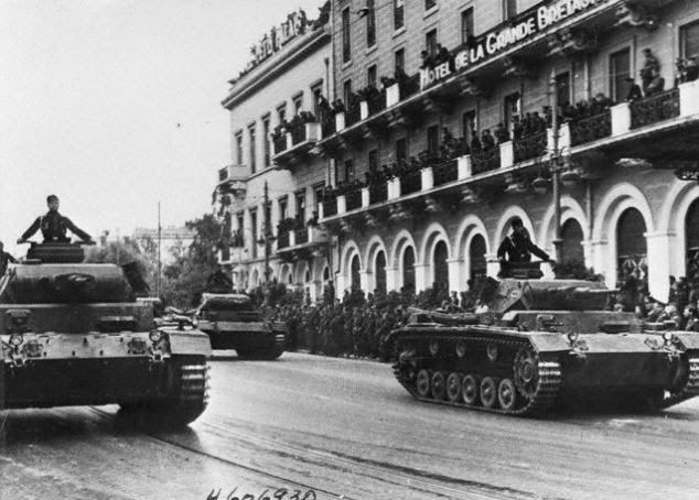 German Tanks Rumbling Through Streets