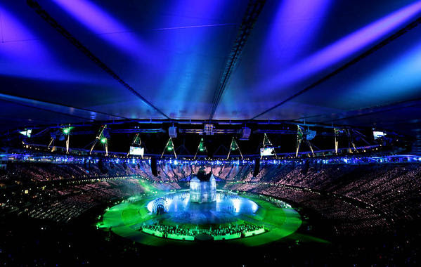 Olympic Stadium glows blue and green during the opening ceremony on  Friday.