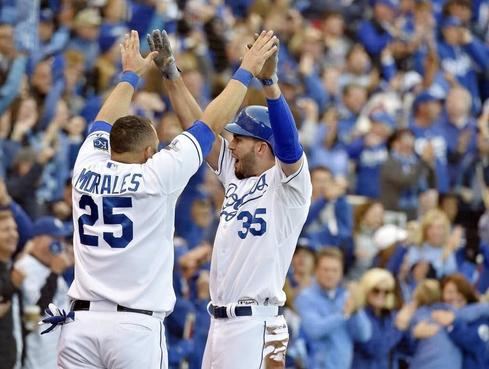 Kansas City Royals first baseman Eric Hosmer celebrated with designated hitter Kendrys Morales after Hosmer scored on a single by third baseman Mike Moustakas to tie up the game 3-3 during Game 2 of the ALCS on Saturday at Kauffman Stadium in Kansas City, Mo.