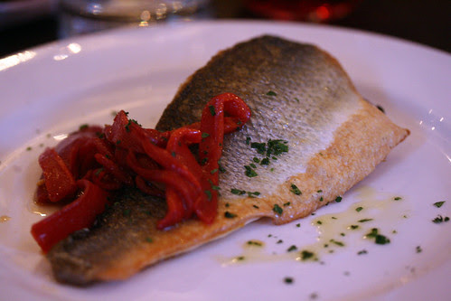 Sea bass with black pudding and peppers