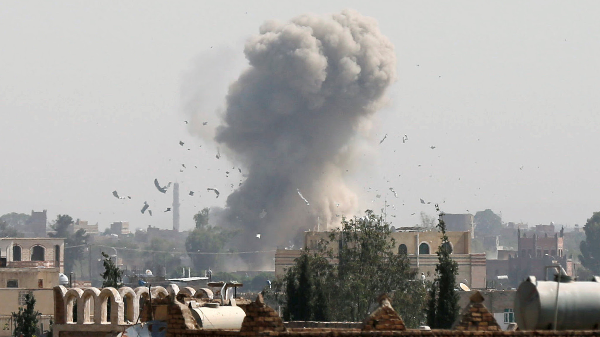 Smoke and debris rise from the site of a Saudi-led air strike in Sanaa