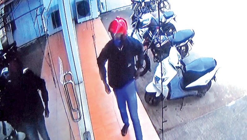 CCTV footage show the man entering the bank.