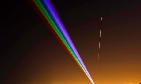 A meteor passes the Global Rainbow laser installation in Whitley Bay
