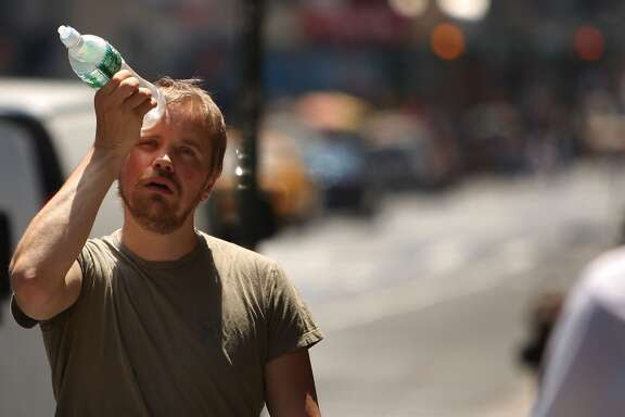 New York City Hit With Stifling Record Heat NEW YORK - JUNE 9: A man tries to cool himself with a bottle of water during the first heat wave of the year June 9, 2008 in New York City. According to the National Weather Service temperatures will near 100 degrees today in the New York metro area with no relief in sight until Wednesday, June 11. (Photo by Spencer Platt/Getty Images)