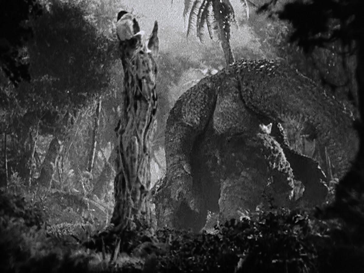 Kong flips a tyrannosaur.