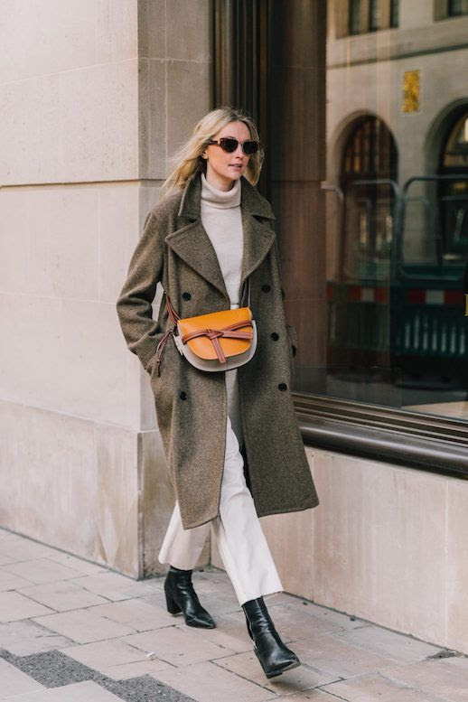 Le Fashion Blog London Fashion Week Classic Street Style Oval Sunglasses Wool Coat Cream Neutral Turtleneck White Straight Leg Jeans Black Leather Boots Via Collage Vintage