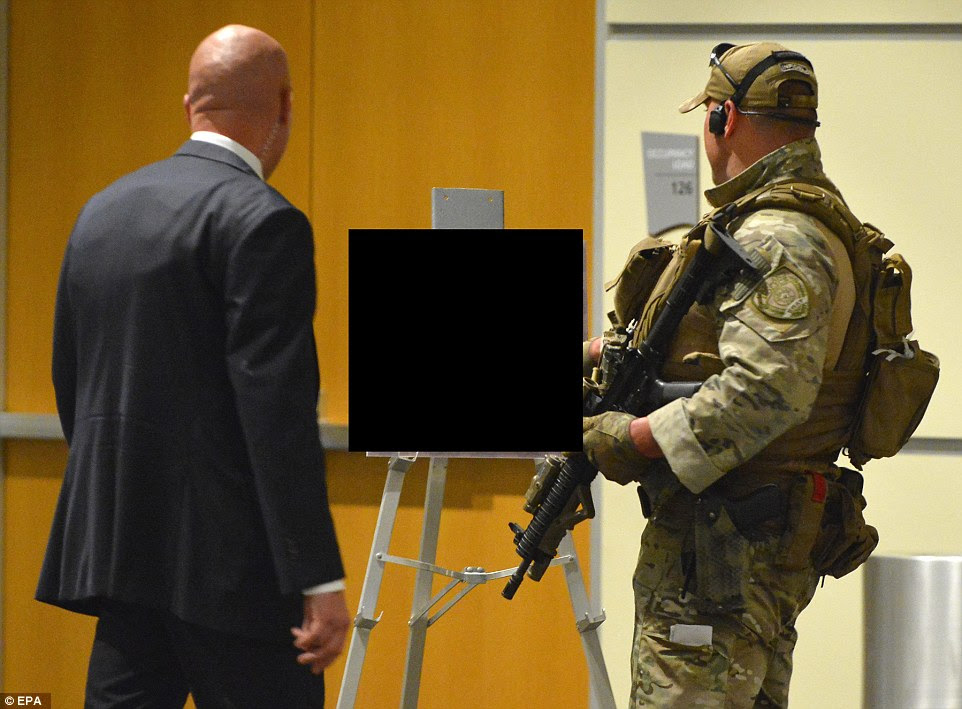 Heavily armed police secure art work inside the Curtis Culwell Center in Garland, Texas, after two suspects opened fire at a r before they were shot dead