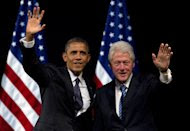 FILE - In this June 4, 2012 file photo, President Barack Obama and former President Bill Clinton wave to the crowd during a campaign event at the New Amsterdam Theater in New York. Clinton will have a marquee role in this summer's Democratic National Convention, where he will make a forceful case for Obama's re-election and his economic vision for the country, several Obama campaign and Democratic party officials said Sunday, July 29, 2012. (AP Photo/Carolyn Kaster, File)