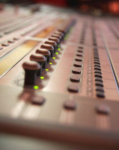 Buttons on the mixing console in Erik's studio