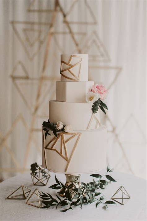 Picture Of a white wedding cake with geometric layers and