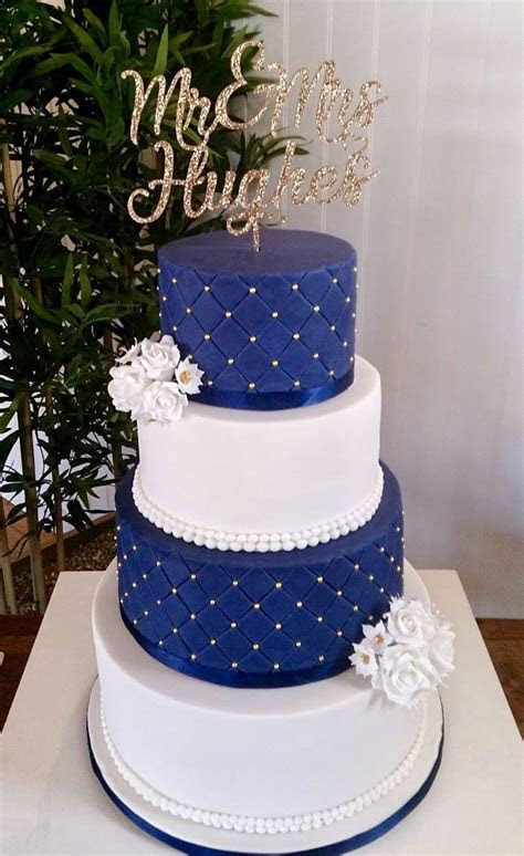 Navy blue and white wedding cake with gold detailing