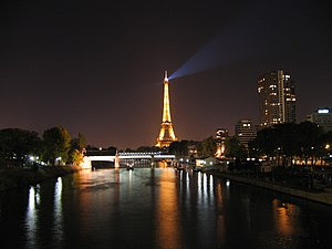 The Eiffel tower and the Seine at night, looki...