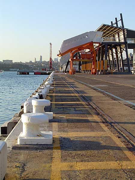 empty wharf, bollards in a row and passenger gangways