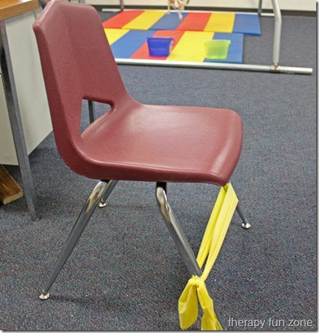 Letting feet stay busy ... students can push on the band while sitting in their chair. This will help the child who needs constant movement.  I know I've had luck with the little bouncy cushions.  This is probably an easier and cheaper option. Also, helps those chair tippers;)