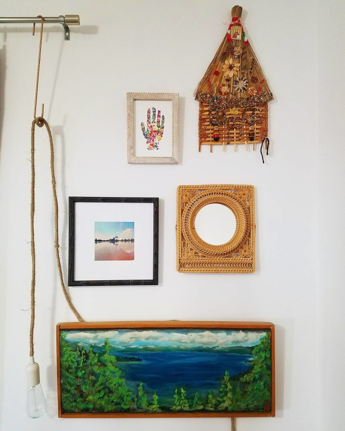 global wall of art with morocco print boho hand wicker mirror thrifted waterscape and handmade hut