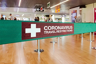 coronavirus travel restriction airport sign