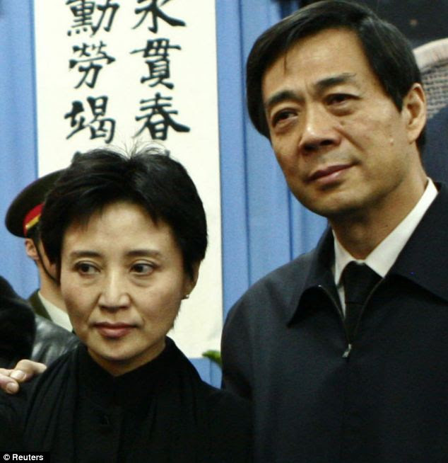 Political scandal: Gu Zailai, left, with her husband - former Chongqing Municipality Communist Party Secretary Bo Xilai. The murder case is one of China's biggest political scandals