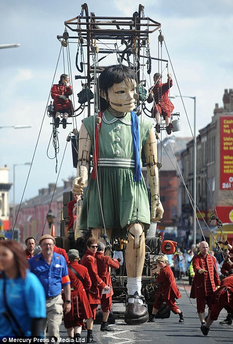 "A giant puppet, part of a street theatre production entitled ""Sea Odyssey"", in Anfield"
